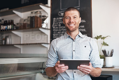 Buy stock photo Portrait of a business owner using a digital tablet in his cafe