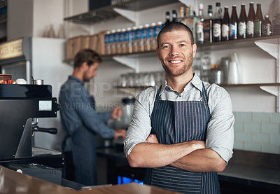Buy stock photo Portrait of a mature man working in a cafe with his colleague in the background