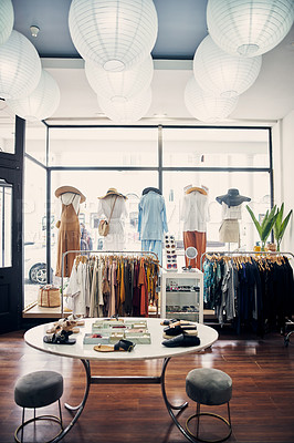 Buy stock photo Shot of the inside of a clothing store