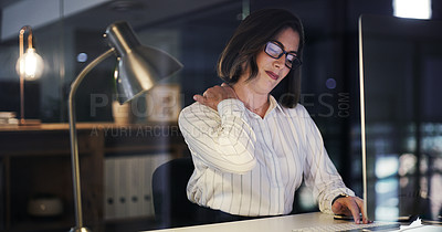 Buy stock photo Cropped shot of an attractive young businesswoman suffering with neck pain while working late in a modern office