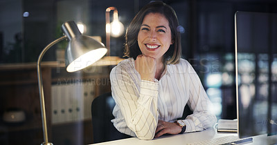 Buy stock photo Cropped portrait of an attractive young businesswoman smiling while working late in a modern office
