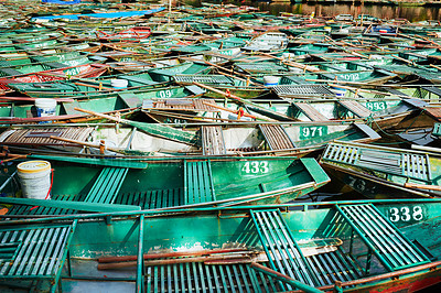 Buy stock photo Shot of a group of boats floating on a river in Vietnam