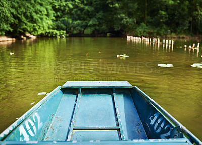 Buy stock photo Shot of a boat floating down a river in Vietnam