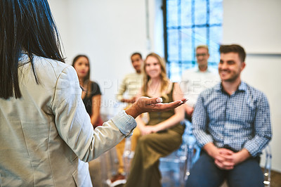 Buy stock photo Cropped shot of an unrecognizable businesswoman addressing her team during a seminar in a modern office