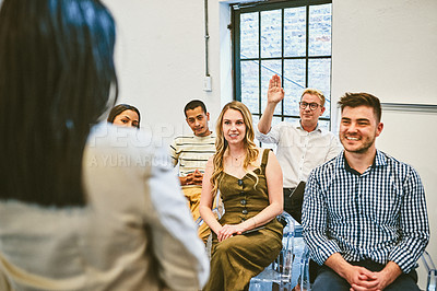 Buy stock photo Cropped shot of a handsome young businessman raising his hand to ask a question during a seminar in a modern office