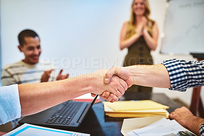 Buy stock photo Cropped shot of two unrecognizable businessmen shaking hands during a seminar in a modern office