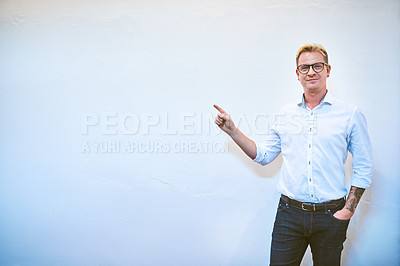 Buy stock photo Cropped portrait of a handsome middle aged businessman pointing up while standing against a white background