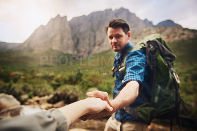 Buy stock photo Defocused shot of a man holding an unrecognisable woman's hand while hiking