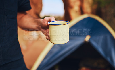 Buy stock photo Shot of an unrecognisable man drinking coffee while camping in the wilderness