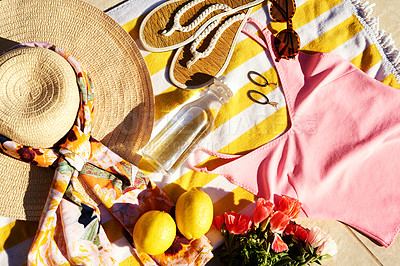 Buy stock photo High angle shot of neatly arranged summer wear laid out on a beach towel during the day