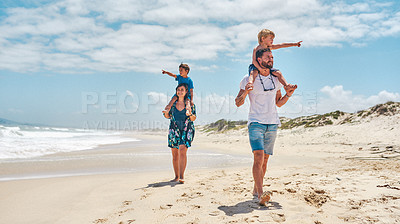 Buy stock photo Shot of a happy young family spending a fun day at the beach