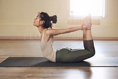 Buy stock photo Full length shot of an attractive young woman stretching and working out in a yoga studio