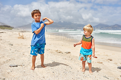 Buy stock photo Shot of two adorable little boys at the beach