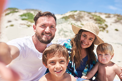 Buy stock photo POV shot of a happy family taking selfies together at the beach