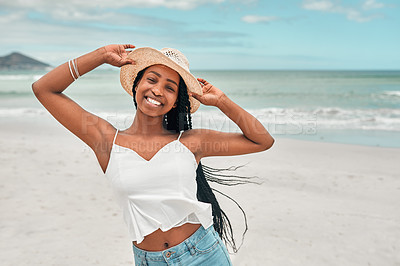 Buy stock photo Portrait of an attractive young woman spending some time at the beach