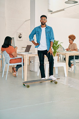 Buy stock photo Full length portrait of a handsome young man standing with his skateboard in a coworking office space