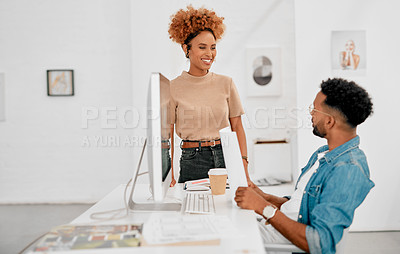 Buy stock photo Shot of a young businesswoman and businessman having a discussion in a modern office