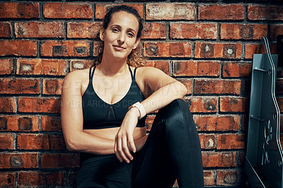 Buy stock photo Cropped shot of a sporty young woman taking a break after her workout