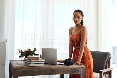 Buy stock photo Cropped portrait of an attractive young businesswoman standing alone in her home office during a day off