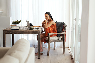 Buy stock photo Full length portrait of an attractive young businesswoman sitting alone in her home office during a day off