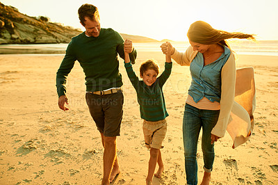 Buy stock photo Shot of a couple spending the day at the beach with their son