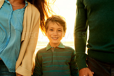 Buy stock photo Cropped shot of a young boy spending the day at the beach with his parents