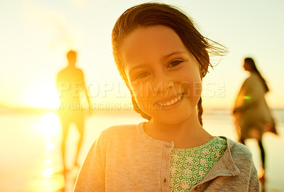Buy stock photo Cropped shot of an adorable little girl enjoying ourselves at the beach