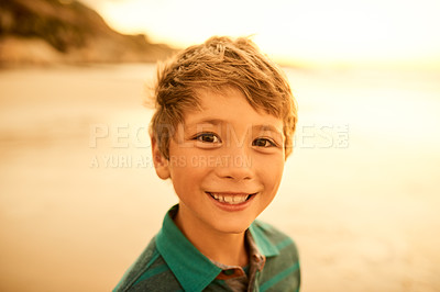 Buy stock photo Cropped shot of a little boy spending the day at the beach
