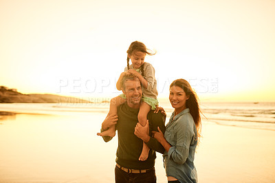 Buy stock photo Shot of a couple spending the day at the beach with their daughter