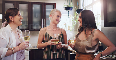 Buy stock photo Shot of a group of young friends having wine while preparing a festive meal at home