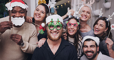 Buy stock photo Portrait of a group of young friends wearing funny hats and glasses at a Christmas party