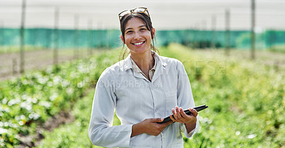 Buy stock photo Portrait of an attractive young scientist using a digital tablet while studying plants and crops outdoors on a farm