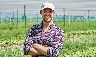 Buy stock photo Portrait of a handsome young farmer posing outdoors on his farm