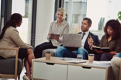 Buy stock photo Shot of a group of businesspeople working together in an office