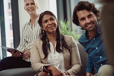 Buy stock photo Shot of a mature businesswoman working alongside her colleagues in an office