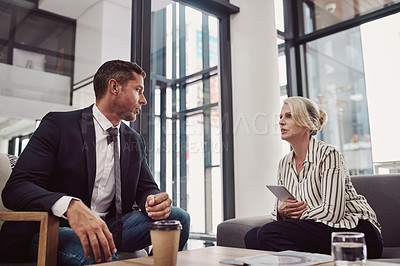 Buy stock photo Shot of two mature businesspeople having a discussion in an office