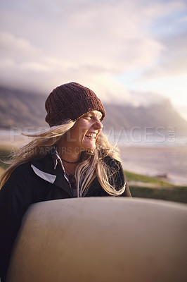 Buy stock photo Shot of an attractive young woman out surfing in the wilderness