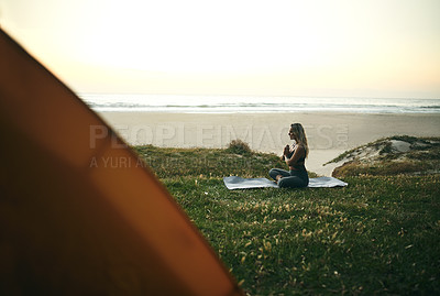 Buy stock photo Full length shot of an attractive young woman sitting alone and meditating during a relaxing day outdoors