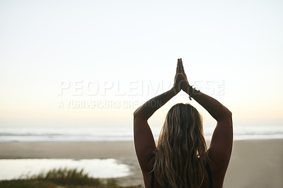 Buy stock photo Cropped shot of an unrecognizable woman standing alone and meditating during a relaxing day outdoors