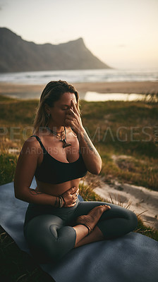 Buy stock photo Full length shot of an attractive young yogi sitting alone and putting pressure on the third eye pressure point