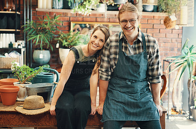Buy stock photo Cropped portrait of two young business owners sitting in their floristry together during the day