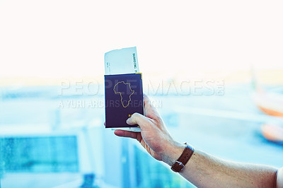 Buy stock photo Cropped shot of a man getting his passport and boarding pass ready before his flight at an airport