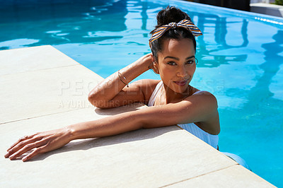 Buy stock photo Shot of a beautiful young woman relaxing in a swimming pool