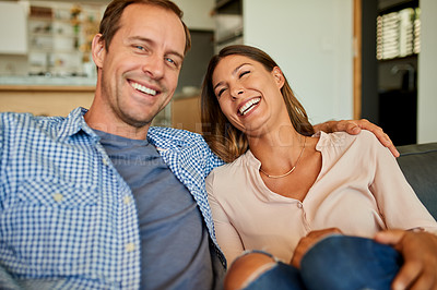 Buy stock photo Portrait of a happy young couple relaxing together on the sofa at home