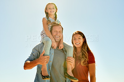 Buy stock photo Shot of an adorable little girl having a fun day outdoors with her mother and father