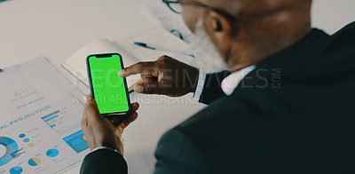 Buy stock photo Cropped shot of a mature businessman using a smartphone inside his office