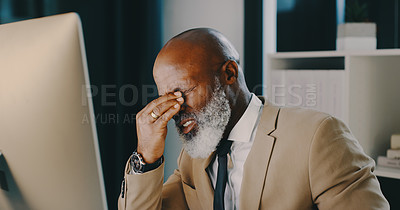 Buy stock photo Shot of a mature businessman feeling stressed out and suffering from a headache while working late inside his office