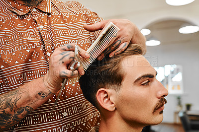 Buy stock photo Cropped shot of an unrecognizable barber standing and cutting a client's hair in his salon