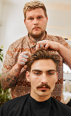 Buy stock photo Cropped portrait of a handsome young barber standing and cutting a client's hair in his salon