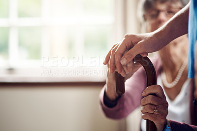 Buy stock photo Cropped shot of a nurse caring for a senior patient with a walking stick at home